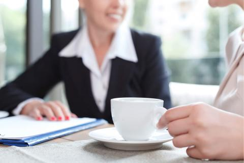 Image of a job seeker conducting an informational interview over coffee.