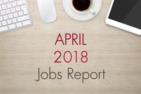 "An image of a desk with text that reads, ""April 2018 Jobs Report"""