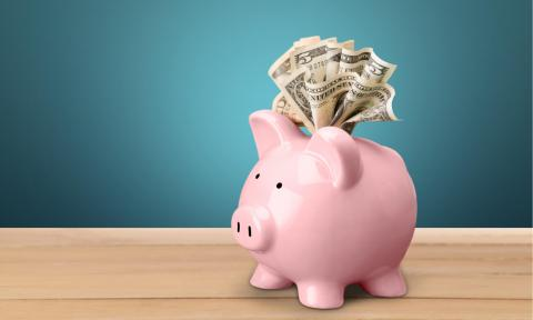 Image of an overflowing piggy bank representing today's top-paying jobs.