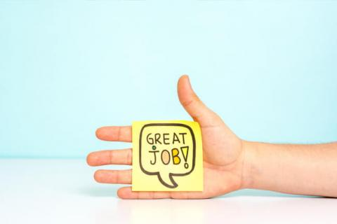 6 Sure-Fire Ways to Boost Employee Job Satisfaction — photo of hand holding sticky with words, Great Job!