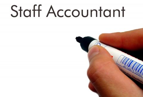 How to Win With a Staff Accountant Job Description — hand with marker and white board with words staff accountant