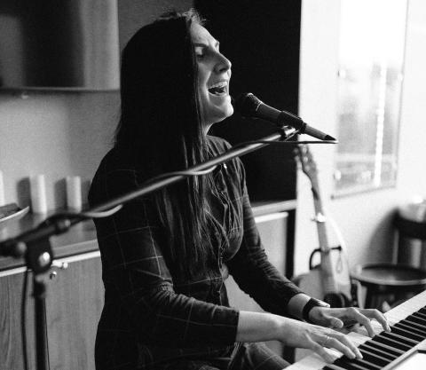 Sing Your Heart Out: Finding a Second Passion in the Music World — Sarah Cotner singing and playing the piano