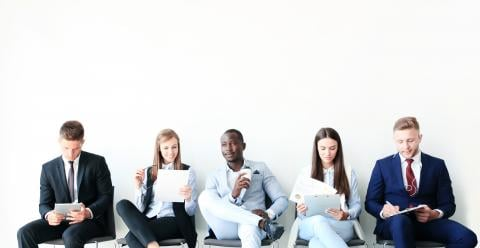 Behavioral Interview Questions and How to Answer Them — five people sitting in chairs awaiting interviews