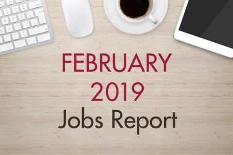 "An image of a desk with text that reads, ""February 2019 Jobs Report"""