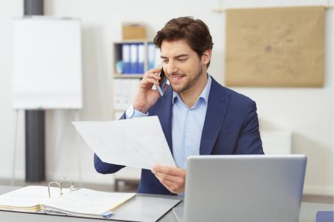 How to Become an Accountant: A 6-Step Plan — man with phone looking at document