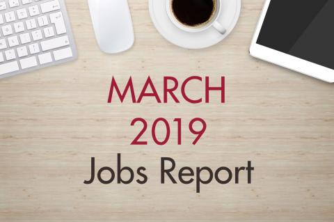 "An image of a desk with text that reads, ""March 2019 Jobs Report"""
