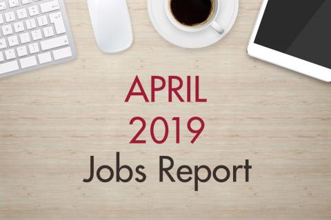 "An image of a desk with text that reads, ""April 2019 Jobs Report"""