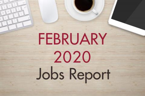 "An image of a desk with text that reads, ""February 2020 Jobs Report"""