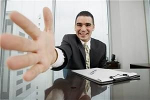 Man holding out hand to show example of how not to conduct an interview