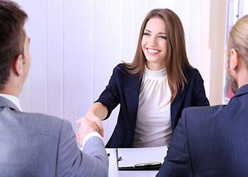 Woman shaking hands during a group interview