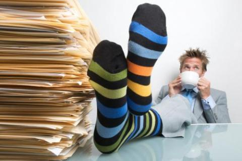Man with striped socks taking some time off at work