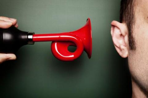 Red air horn and an ear symbolizing retention strategies