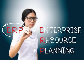 Woman writing ERP and Enterprise Resource Planning, preparing for an ERP upgrade