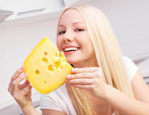 Comparing Yourself to Cheese Won't Impress Employers — woman with piece of cheese