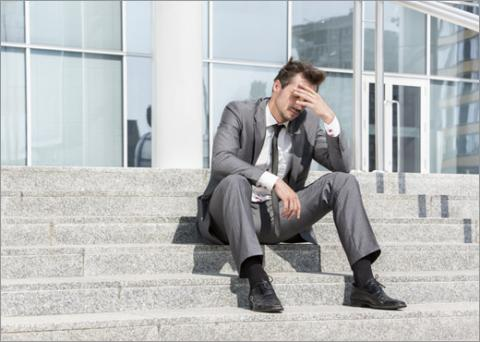 Man sitting on steps, dejected and symbolizing feeling of hating your job