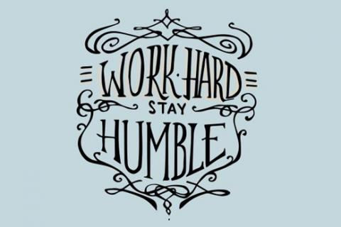 "The words ""Work Hard, Stay Humble"" in fancy font"