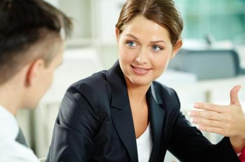 Woman speaking to man, displaying active listening skills
