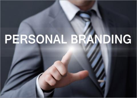 "Man putting his finger on the words, ""personal branding"""