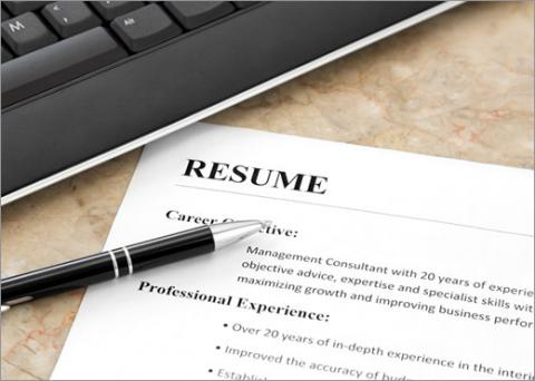 resume and a pen to demonstrate best resume writing tips - Resume Writing
