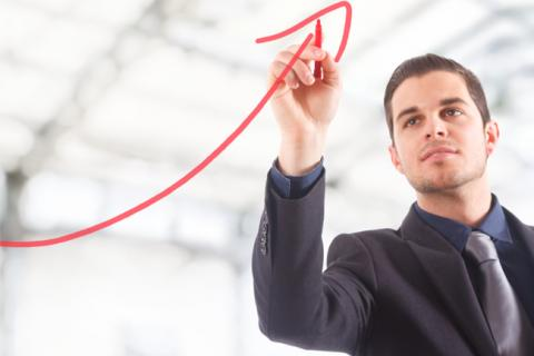 Man draws a big red arrow to show how to become a CFO