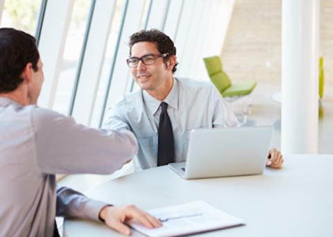 Job recruiter greets candidate
