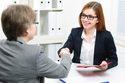 Women shaking hands at an interview