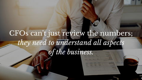 CFO sitting at desk with words: CFOs can't just review the numbers