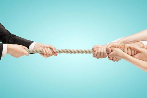 Why You Should Say NO to a Counteroffer. Hands on both sides of rope in a tug of war.