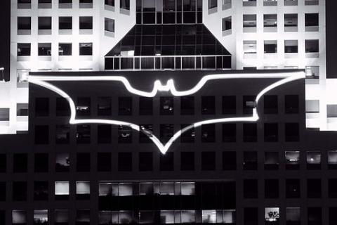Lights on building in shape of a bat, comparing Batman to business analyst