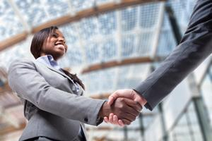 Woman shaking hand of an executive-level job seeker