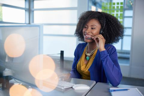 A customer service professional at her desk embodies the ideal customer service mindset