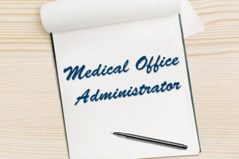 All You Need To Know For A Medical Office Administrator Career — notepad with pen and the words: Medical Office Administrator