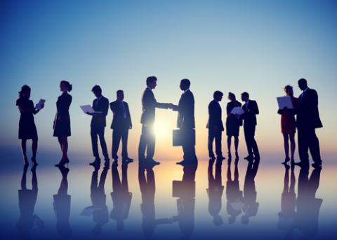 How and Why to Embrace Boomerang Hiring — shadows of business people shaking hands as the sun is on horizon