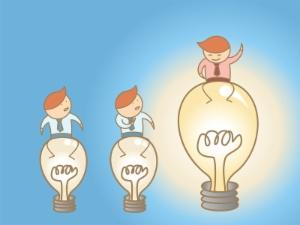 Illustration of an employee standing on top of a lightbulb.