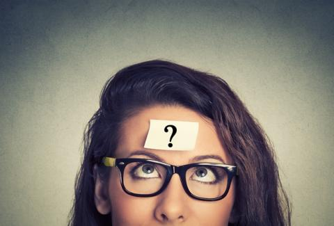 Woman with question mark on forehead.