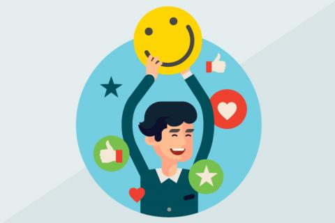 Illustration of a worker holding up a happy emoji.