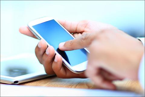 Hand using smartphone, an integral part of workplace communication