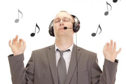 Man listening to tunes to have more fun at work