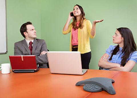 Annoying workplace behavior — talking on a phone during meeting