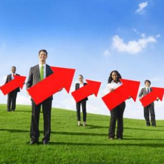 Image of finance and accounting employees holding arrows pointing skyward to signify professional development
