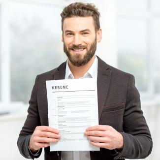 Job seeker holding resume after following accounting resume tips