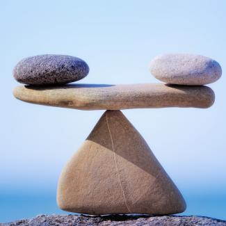 Balancing rocks to illustrate the concept of work-life balance.