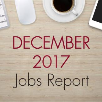 "An image of a desk with text that reads, ""December 2017 Jobs Report"""