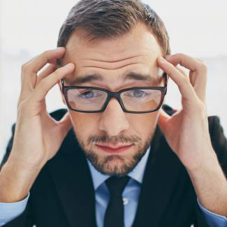 Image of a hiring manager looking frustrated due to recruiting challenges.