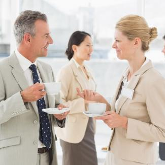 Two Business Executives Talking at a Networking Event