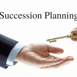 Two hands and a key as a symbol of succession planning