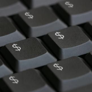 Illustration of dollar signs on a keyboard.