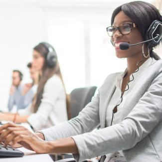 Make the Most of Customer Service Week — photo of professional women with headphones working at computers