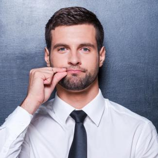 Vote Against Talking Politics in the Workplace — Man pretending to zip up his lip
