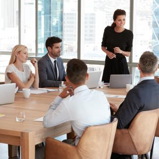 5 New Manager Tips That Can Help Experienced Leaders Succeed, Too - Female executive leading a team meeting.